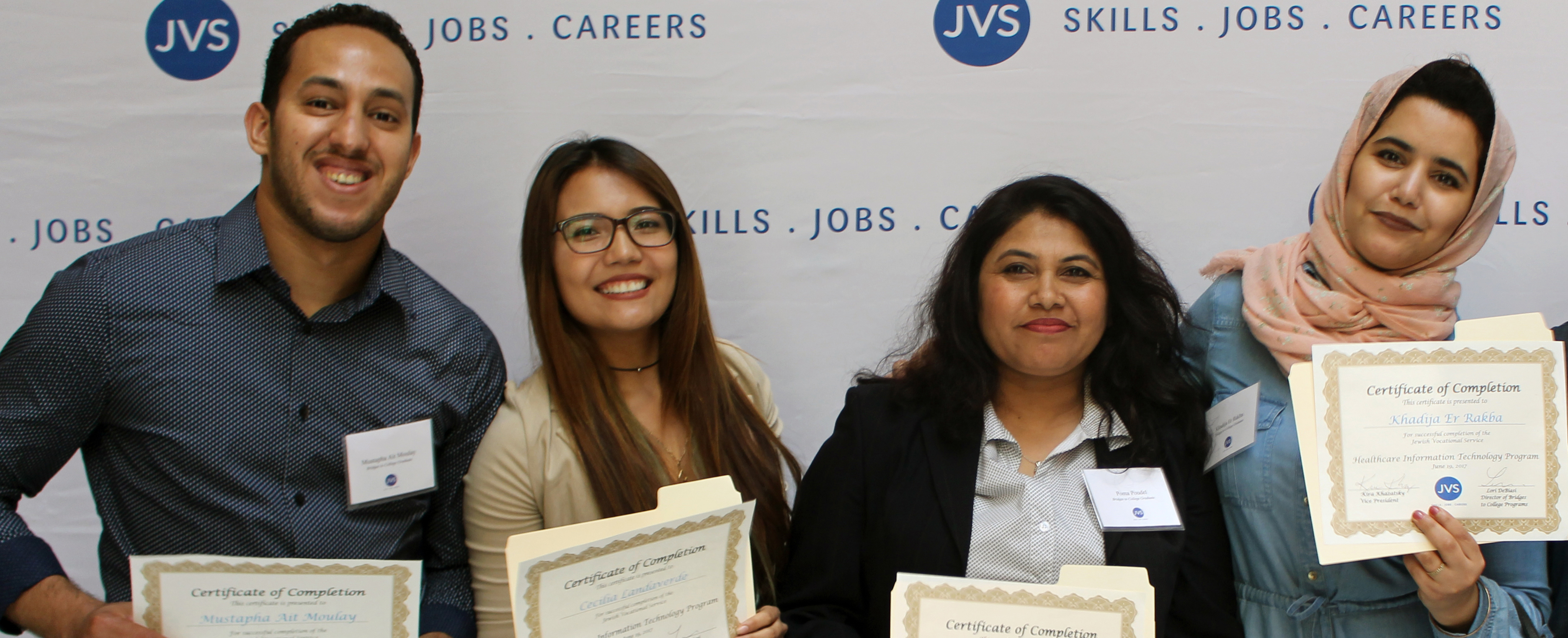 JVS Bridges to College students holding up their graduation certificates