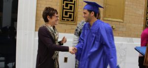 A career coach shaking hands with a JVS graduate student