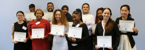 JVS students holding Pharmacy Technician Training Program certificates of completion