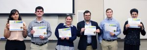 JVS Graduates smile with their certificates