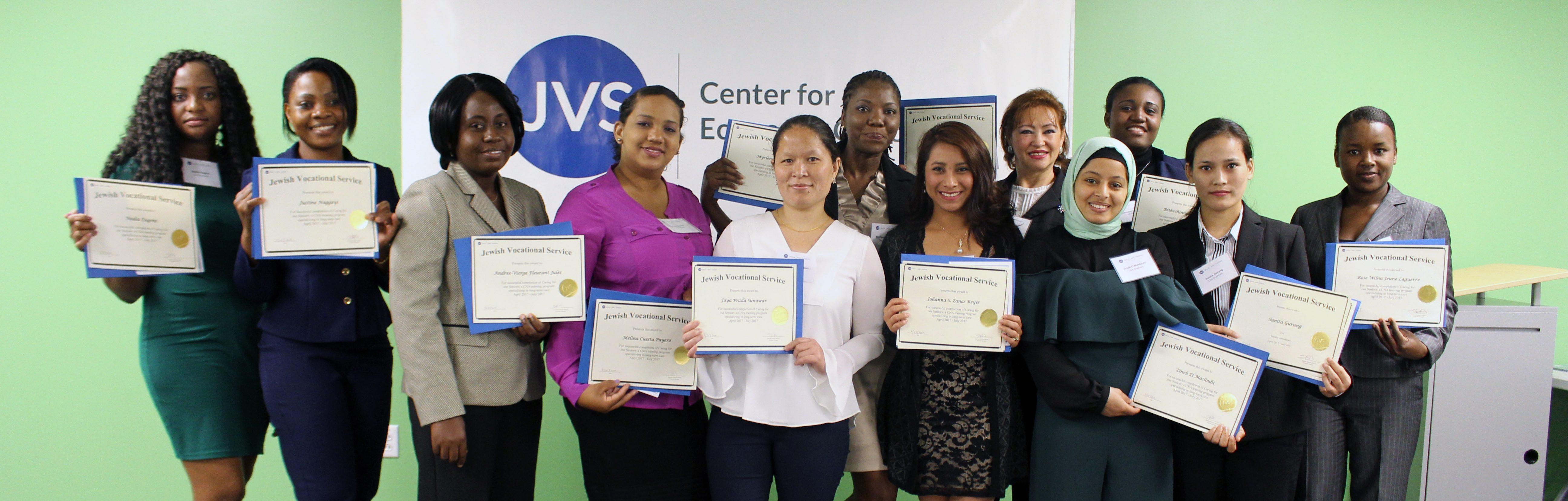 JVS Nursing Assistant Training Program graduates holding their certificates at graduation