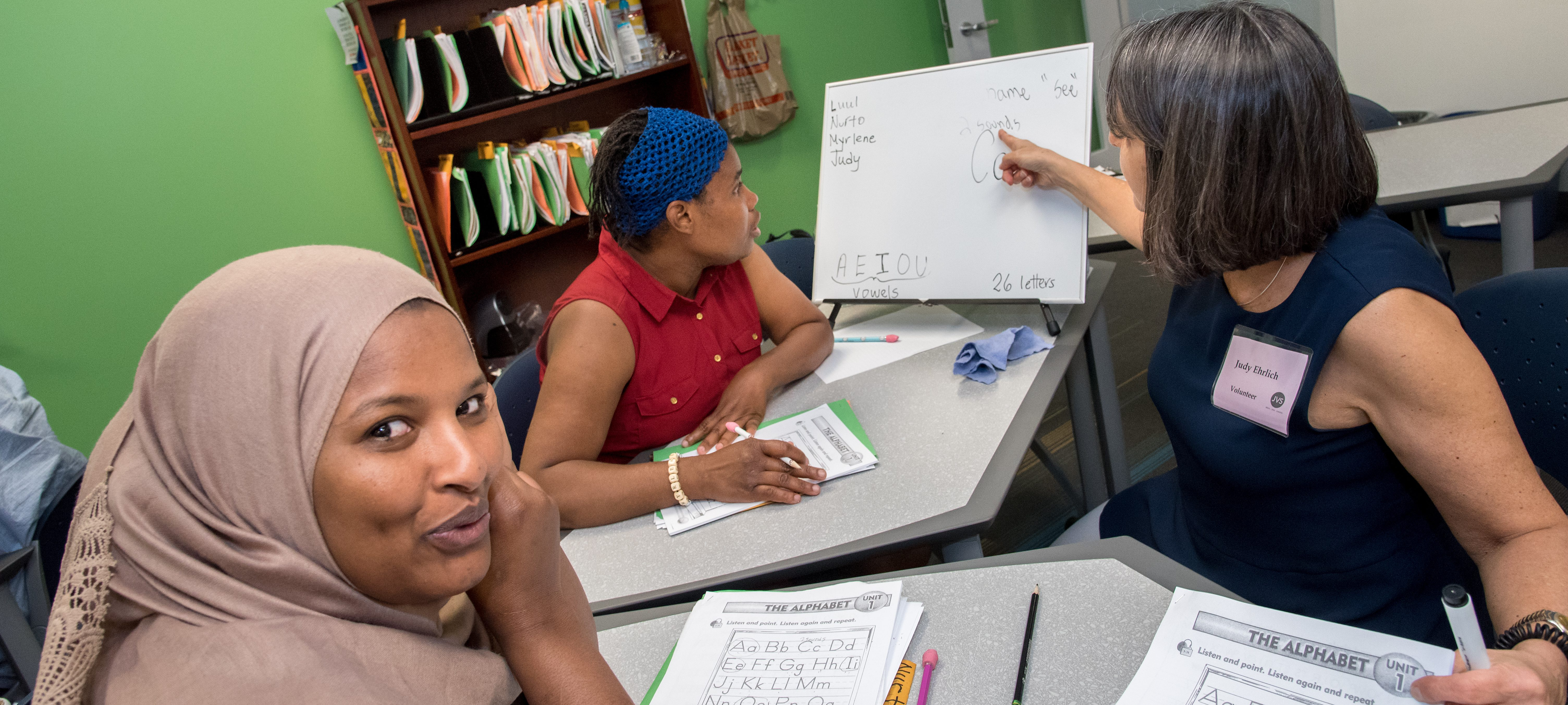 JVS Refugee students learning basic English in ESOL